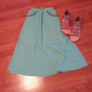 Light green maxi skirt with embroidered detail